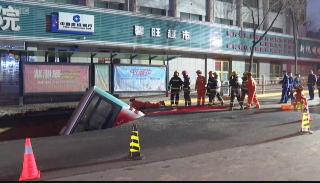 China sinkhole: Six killed as ground swallows bus