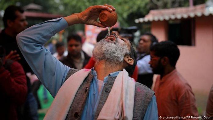 Hindu group hosts cow urine drinking party to ward off coronavirus